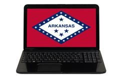 Laptop computer with  flag of american state of arkansas Stock Photos