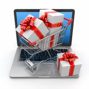 E-commerce. shopping cart and gifts on laptop. 3d Stock Illustration