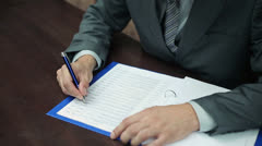 Businessman hands writing notes on documents HD Stock Footage