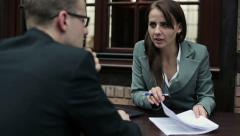 Job interview, businessman talking to businesswoman HD - stock footage
