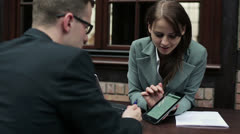 Businesswoman with tablet computer talking to client HD Stock Footage