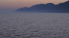 Night falls over the coast in Dubrovnik archipelago - stock footage