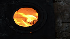 Fire burn view round hole of old retro rural rusty stove furnace Stock Footage