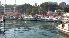 Boats with turkish flags in Kaleici harbor Stock Footage