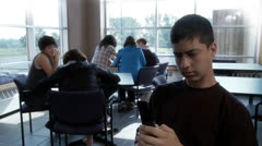 High school student texting and ignoring other people Stock Footage