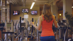Fit Girl Exercising On An X-Trainer Cardio Machine Stock Footage
