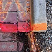 paving needing repair - stock photo