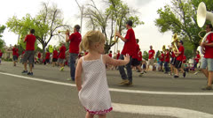 Little girl waves at rural marching band HD 033 Stock Footage
