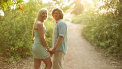 Young Couple Walking Path in Nature Stock Footage