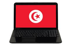 Laptop computer with  national flag of tunisia Stock Photos