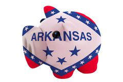 Piggy rich bank in colors  flag of american state of arkansas    for saving m Stock Photos
