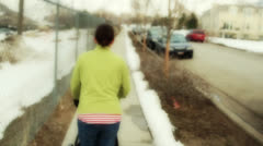 A woman pushing a stoller Stock Footage