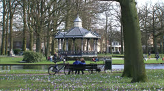 People in city park, springtime, The Netherlands Stock Footage