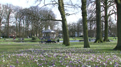 People enjoying spring in city park, Oranjepark Apeldoorn, The Netherlands Stock Footage