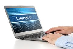 Hands typing on laptop. copyright message concept Stock Photos