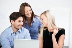 colleagues at the office having a chat - stock photo