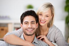 young couple with beautiful smiles - stock photo