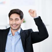 successful businessman cheering - stock photo