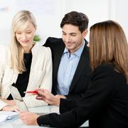 Young couple with a business adviser Stock Photos