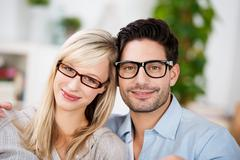Attractive young couple wearing glasses Stock Photos