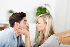 Couple puckering lips at home Stock Photos