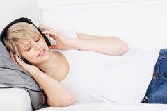Woman wearing headphones listening to music Stock Photos