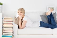 young woman relaxing on a sofa - stock photo