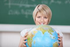 young female student with a world globe - stock photo