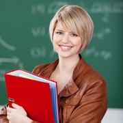 Stock Photo of vivacious female student with class notes
