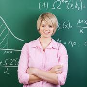 Young student or teacher with folded arms Stock Photos