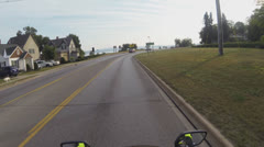 POV of Motorcycle Rider in Small City in Michigan's Upper Peninsula Stock Footage