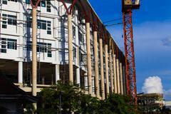 Apartments construction site with yellow crane Stock Photos
