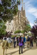 people photograph sagrada familia cathedral, designed by antoni gaudi, in bar - stock photo