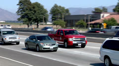Stock Video Footage of 101 freeway LA County firefighter hero pickup red traffic flowing cars traveling