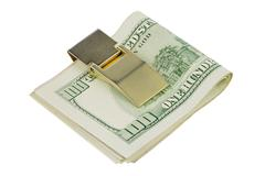 one hundred dollars banknotes in money clip - stock photo