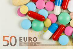 fifty euro banknote whith pills on it - stock photo