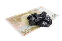 Fifty euro banknote whith raw coal nuggets on it Stock Photos