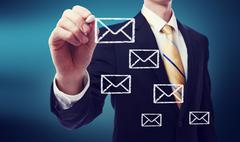 Business man with email envelopes Stock Photos