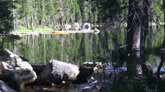 Yellow canoe on lake Stock Footage