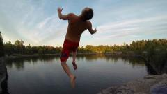 Extreme Sports - Cliff Jumping Flips - 2 angles - stock footage