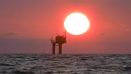Stock Video Footage of Beautiful Sunset with Off-Shore Oil Platform.