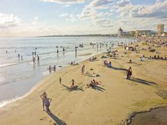 Crowd enjoying summer at the beach Stock Photos