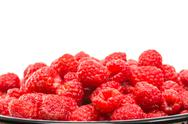Stock Photo of bowl of red raspberries on white
