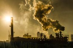 air pollution coming from factory smoke - stock photo