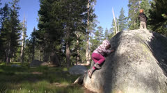 Children climbing rocks Stock Footage