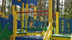 Kid Playing in Public Playground - stock footage