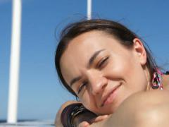 Beautiful woman smiling on a background of blue sky, close up NTSC - stock footage