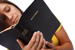 Young lady reading bible Stock Photos