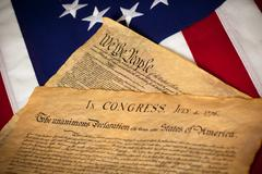 united states constitution and declaratin of independence on flag - stock photo