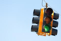 green light traffic signal with copy space - stock photo